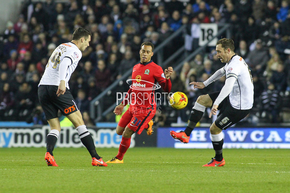 Derby County defender Richard Keogh clears the ball from the approaching Blackburn Rovers midfielder Elliott Bennett during the Sky Bet Championship match between Derby County and Blackburn Rovers at the iPro Stadium, Derby, England on 24 February 2016. Photo by Aaron  Lupton.