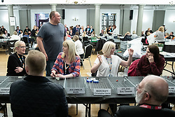 © Licensed to London News Pictures . 02/05/2019. Bolton, UK. Ballot counters talk to each other during the count . The count for Bolton Council at Bolton Town Hall . The Labour Party are threatened to lose their majority on the council . Local council elections are taking place across the country . Photo credit: Joel Goodman/LNP