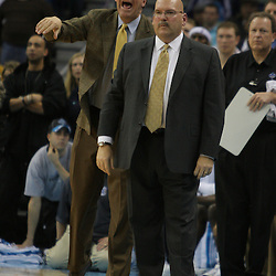 Jan 08, 2010; New Orleans, LA, USA; New Orleans Hornets assistant coach Tim Floyd (left) and head coach Jeff Bower instruct the offense in the fourth quarter against the New Jersey Nets at the New Orleans Arena. The Hornets defeated the Nets 103-99. Mandatory Credit: Derick E. Hingle-US PRESSWIRE.