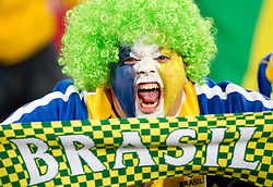A Brazil fan enjoys the atmosphere ahead of the 2010 FIFA World Cup South Africa Group G match between Brazil and North Korea at Ellis Park Stadium on June 15, 2010 in Johannesburg, South Africa.  (Photo by Vid Ponikvar / Sportida)