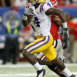 Dec 3, 2011; Atlanta, GA, USA; LSU Tigers running back Alfred Blue (4) runs for a touchdown against the Georgia Bulldogs during the second half of the 2011 SEC championship game at the Georgia Dome.  Mandatory Credit: Derick E. Hingle-US PRESSWIRE