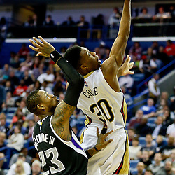 Mar 7, 2016; New Orleans, LA, USA; New Orleans Pelicans guard Norris Cole (30) shoots over Sacramento Kings guard Ben McLemore (23) during the second half of a game at the Smoothie King Center. The Pelicans defeated the Kings 115-112. Mandatory Credit: Derick E. Hingle-USA TODAY Sports
