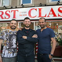 Scotland's Chairty Air Ambulance pilot Clark Priestly (centre) pictured at First Class Barber's in South Street Perth with owner Ferdi Gul (right) and Emre  , after having a haircut, beard trim, hair wash, hot towel and massage, which are some of the services that owner Ferdi Gul and his team will be offering to customers on Sunday 27th July when all proceeds from the day will be donated to SCAA....<br /> Picture by Graeme Hart.<br /> Copyright Perthshire Picture Agency<br /> Tel: 01738 623350  Mobile: 07990 594431