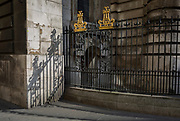 Sunlit railings of St. Mary Woolnoth church on Lombard Street, on 10th May 2017, in the City of London, England.