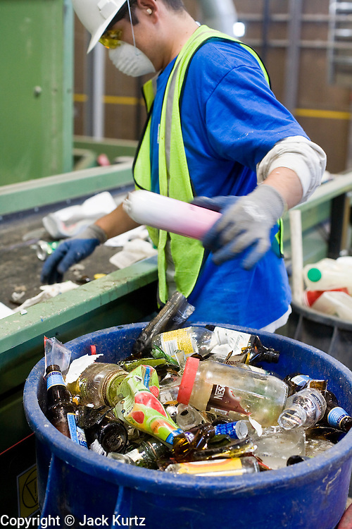 12 MARCH 2007 -- PHOENIX, AZ: PEDRO ROMERO sorts recyclables from non recyclables at the new recycling center in the city of Phoenix, AZ. The center opened in February 2007 and is the most modern recyclables processing center in the US. The center is operated by Hudson Baylor Corporation and processes about 1000 tonnes of recyclables a week.  Photo by Jack Kurtz/ZUMA Press