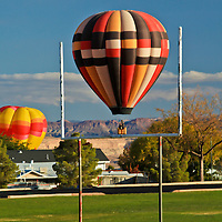 Balloons touchdown near a football field in Page, Arizona during the 2011 Balloon Regatta.