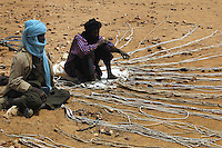 BURKINA FASO, Gorom-Gorom, 2007. Tuareg nomads sell halters and lead ropes for a variety of animals at Gorom-Gorom's Thursday animal market.