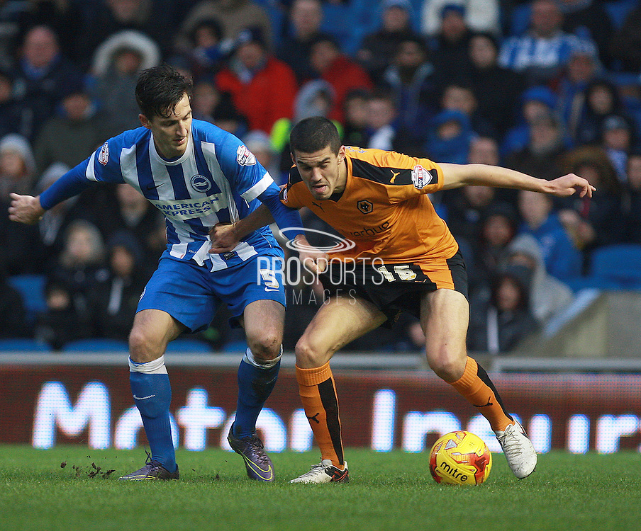 Wolverhampton Wanderers midfielder Conor Coady shields the ball from Brighton central defender Lewis Dunk during the Sky Bet Championship match between Brighton and Hove Albion and Wolverhampton Wanderers at the American Express Community Stadium, Brighton and Hove, England on 1 January 2016. Photo by Bennett Dean.