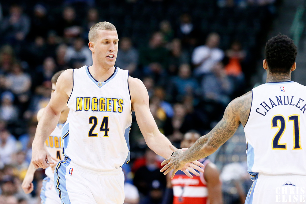 08 March 2017: Denver Nuggets center Mason Plumlee (24) is congratulated by Denver Nuggets forward Wilson Chandler (21) during the Washington Wizards 123-113 victory over the Denver Nuggets, at the Pepsi Center, Denver, Colorado, USA.