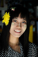 Burmese woman portrait with flowers and thanakha Burma Myanmar