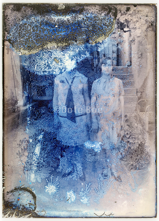 severely eroding glass plate with two young women standing full length