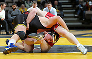 Iowa's Blake Rasing works against Southern Illinois Edwardsville's David Devine during the heavyweight bout of their dual at Carver-Hawkeye Arena, 1 Elliot Drive in Iowa City on Friday evening January 7, 2010. Rasing defeated Devine 7-4 and Iowa defeated Southern Illinois Edwardsville 49-0.