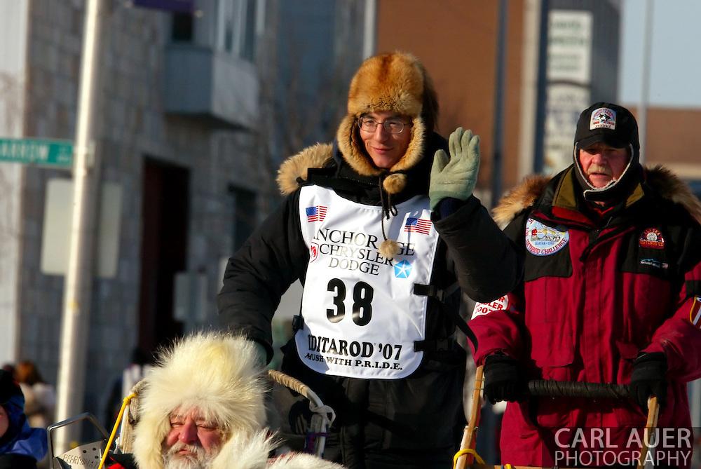 3/3/2007:  Anchorage Alaska -  Veteran Ryan Redington of Wasilla, AK, the son of Iditarod veteran, Raymie Redington and grandson of Iditarod co-founder, Joe Redington, Sr. heads out during the Ceremonial Start of the 35th Iditarod Sled Dog Race