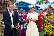 "CATHERINE, DUCHESS OF CAMBRIDGE LOOK ON AS PRINCE WILLIAM.cracks open a coconut with a machete in Funafuti, Tuvalu_18/09/2012.Mandatory credit photo: ©DIASIMAGES/NEWSPIX INTERNATIONAL..(Failure to credit will incur a surcharge of 100% of reproduction fees)..                **ALL FEES PAYABLE TO: ""NEWSPIX INTERNATIONAL""**..IMMEDIATE CONFIRMATION OF USAGE REQUIRED:.DiasImages, 31a Chinnery Hill, Bishop's Stortford, ENGLAND CM23 3PS.Tel:+441279 324672  ; Fax: +441279656877.Mobile:  07775681153.e-mail: info@newspixinternational.co.uk"