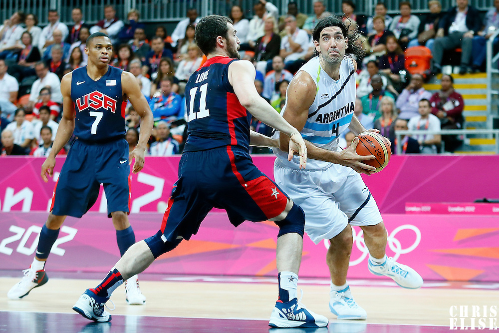06 August 2012: Argentina Luis Scola drives past USA Kevin Love during 126-97 Team USA victory over Team Argentina, during the men's basketball preliminary, at the Basketball Arena, in London, Great Britain.