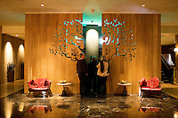 Guests walk through the lobby of Avia Napa, which opened in July 2009, is a five-story, 141-room boutique hotel, and is the tallest building in the city of Napa. Rooms are small but modern, and second floor roof deck has a fire pit for guests only.