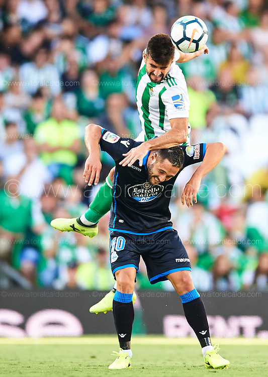 SEVILLE, SPAIN - SEPTEMBER 16:  Antonio Barragan of Real Betis Balompie (L) competes for the ball with Florin Andone of RC Deportivo (R) during the La Liga match between Real Betis and Deportivo La Coruna  at Estadio Benito Villamarin on September 16, 2017 in Seville, .  (Photo by Aitor Alcalde Colomer/Getty Images)
