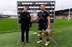 Ollie Griffiths of Dragons receives his Guinness PRO14 Man of the Match award after the final whistle of the match  - Ryan Hiscott/JMP - 25/10/19 - SPORT - Rodney Parade - Newport, Wales -