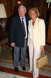 SIR DONALD GOSLING and  at a party to celebrate the opening of The Bar at The Dorchester, Park Lane, London on 27th June 2006.<br />