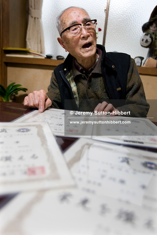 102 year old Takashi Shimokawara, World Record holder for javelin, shot putt and discus, in the Over-100 year olds categories, warming up and practising his sports, in Kamaishi, Japan, Friday 12th December 2008. Shimokawara-san took up the field sports at the age of 98. His world records are for Javelin 12.75metres, discus 8.82metres, and shot putt 5.11metres.