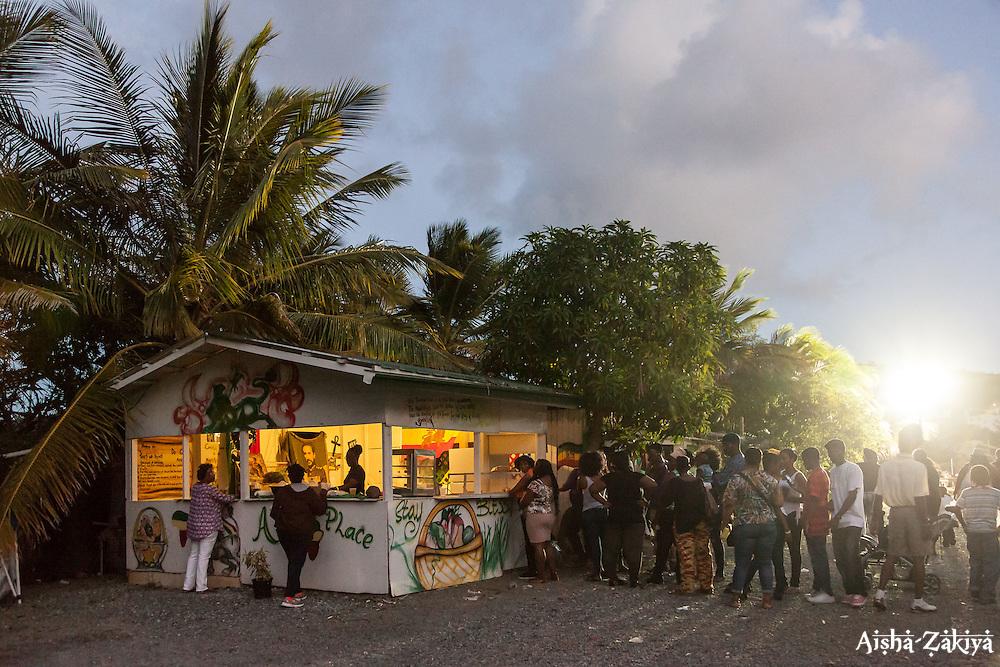 Many vegan vendors saw long lines throughout the day like this one at Ailah's Place.  20th Annual Bordeaux Farmers Rastafari Agricultural & Cultural Vegan Food Fair.  Bordeaux Farmers Market.  St. Thomas, USVI.  14 January 2017.  © Aisha-Zakiya Boyd