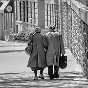I was very fortunate, on a beautiful spring day in New York, I happened to turn around and saw this couple walking arm in arm. It is one of my favorite images. This couple has clearly been together for a long time. If you look closely, they are even walking in step!
