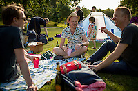 Glasgow, Scotland - JULY 11, 2014: A group of friends picnicking in Kelvingrove Park. On the rare sunny day, the park, which adjoins the trendy Finnieston neighborhood and the University of Glasgow, is a haven for students and families alike. CREDIT: Chris Carmichael for The New York Times