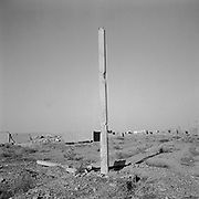 A lone concrete pillar stands out from the ruins of the remains of a bombed out building beside the main compound at Tarnak Farms, the al Qaeda base, training camp and pre 9/11 al Qaeda headquarters in Kandahar, Afghanistan which served as a home to Osama Bin Laden and numerous al Qaeda fighters located outside Kandahar City. It is believed that this base was where the plan for the 9/11 attacks originated, as a result Tarnak Farms was heavily bombed by the United States after September 11, 2001. (Credit Image: © Louie Palu/ZUMA Press)..