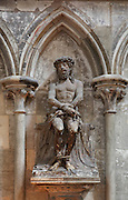 Statue of Christ with hands and feet bound, wearing the crown of thorns, in a Gothic arch niche in the transept of Rouen Cathedral or the Cathedrale de Notre Dame de Rouen, built 12th century in Gothic style, with work continuing through the 13th and 14th centuries, Rouen, Normandy, France. Picture by Manuel Cohen