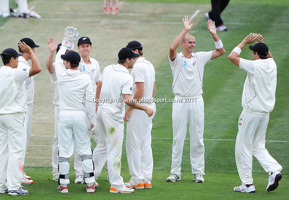 Chris Martin celebrates the wicket of Usman Khawaja on Day 2 of the second cricket test between Australia and New Zealand Black Caps at Bellerive Oval in Hobart, Saturday 10 December 2011. Photo: Andrew Cornaga/Photosport.co.nz