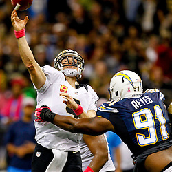 October 7, 2012; New Orleans, LA, USA; New Orleans Saints quarterback Drew Brees (9) throws a touchdown as he is pressured by San Diego Chargers defensive end Kendall Reyes (91) during the second quarter of a game at the Mercedes-Benz Superdome. Mandatory Credit: Derick E. Hingle-US PRESSWIRE