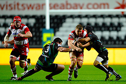 Gloucester Flanker (#6) Ross Moriarty is tackled by Ospreys Prop (#3) Joe Rees during the first half of the match - Photo mandatory by-line: Rogan Thomson/JMP - Tel: Mobile: 07966 386802 09/11/2012 - SPORT - RUGBY - Liberty Stadium - Swansea. Ospreys v Gloucester - LV= Cup