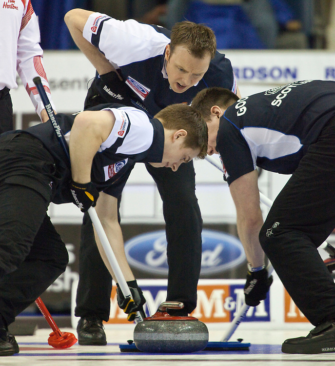 Scottish skip Tom Brewster encourages his sweepers during Scotland's 1-2 playoff match against Canada at the Ford World Men's Curling Championships in Regina, Saskatchewan, April 8, 2011.<br /> AFP PHOTO/Geoff Robins