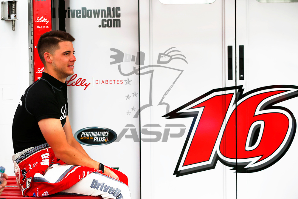 Ryan Reed (16) hangs out in the garage during first practice for the OneMain Financial 200 at Dover International Speedway in Dover, Delaware.
