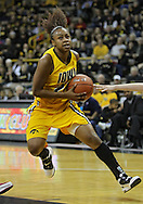 December 09 2010: Iowa guard Kachine Alexander (21) drives to the basket during the first half of their NCAA basketball game at Carver-Hawkeye Arena in Iowa City, Iowa on December 9, 2010. Iowa defeated Iowa State 62-40 in the Hy-Vee Cy-Hawk Series rivalry game.