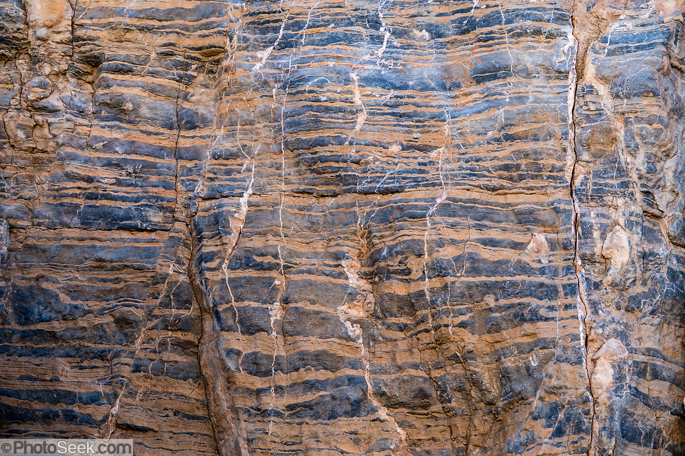 Striped blue and orange rock pattern. Fall Canyon, Death Valley National Park, California, USA.