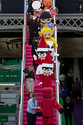 UNITED KINGDOM, London: 22 January 2019. Character's from famous children's shows are taken down the stairs at The Toy Fair 2019 being held at Olympia London this morning. The Toy Fair, which runs between 22nd-24th of January, is the UK's largest toy trade event with over 250 exhibiting companies launching thousands of new products. <br /> Rick Findler / Story Picture Agency
