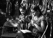 A young girl from the Music for Hope project taking part in a music lesson led by UK based tutor Katherine Rogers.<br /> Community of La Canoa,<br /> Bajo Lempa, El Salvador.1999