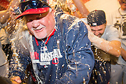 CLEVELAND, OH - APRIL 5: Ron Gardenhire #35 of the Minnesota Twins celebrates with his players in the visitors dugout at Progressive Field after the Twins defeated the Cleveland Indians for Gardenhire's 1,000 carer win on April 5, 2014 in Cleveland, Ohio. The Twins defeated the Indians 7-3. (Photo by Jason Miller/Getty Images)  *** Local Caption *** Ron Gardenhire