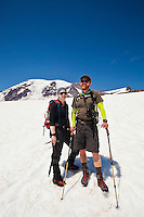 Portrait of a young man and woman on the Muir snowfield on Mount Rainier. Washington, USA.