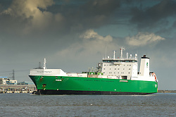 The Ro-Ro cargo ship Misida steams upriver on the River Thames.