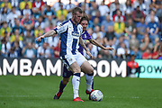 West Bromwich Albion midfielder Chris Brunt (11) battles for possession during the EFL Sky Bet Championship match between West Bromwich Albion and Stoke City at The Hawthorns, West Bromwich, England on 1 September 2018.