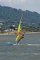 Young girl, wind surfer, novice, wind surfing, Southern Spain, Andalusia, Atlantic Ocean, 200410102974..Copyright Image from Victor Patterson, 54 Dorchester Park, Belfast, UK, BT9 6RJ..Tel: +44 28 9066 1296.Mob: +44 7802 353836.Voicemail +44 20 8816 7153.Skype: victorpattersonbelfast.Email: victorpatterson@mac.com.Email: victorpatterson@ireland.com (back-up)..IMPORTANT: If you wish to use this image or any other of my images please go to www.victorpatterson.com and click on the Terms & Conditions. Then contact me by email or phone with the reference number(s) of the image(s) concerned.