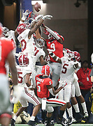 The Alabama defensive backfield leaps to knock down Georgia's last ditch attempt to score as Alabama defeated Georgia 35-38 in the SEC Championship game Saturday, Dec. 1, 2018 in Mercedes-Benz Stadium in Atlanta.  [Staff Photo/Gary Cosby Jr.]