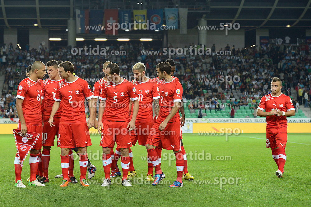 07.09.2012, Ljubljana, SLO, FIFA WM Qualifikation, Slowenien vs Schweiz, im Bild Feature die Spieler machen sich fuer das Teamfoto bereti (R) Xherdan Shaqiri (SUI) // during the FIFA World Championships qualifying match between Slovenia and Switzerland, Ljubljana, Slovenia on 2012/09/08. EXPA Pictures © 2012, PhotoCredit: EXPA/ Freshfocus/ Valeriano Di Domenico..***** ATTENTION - for AUT, SLO, CRO, SRB, BIH only *****