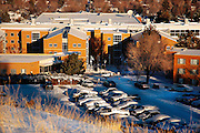 Idaho . Pocatello, ISU Rendevous Center with parking lot covered in fresh snow at sunrise .