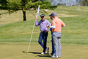 Justin Thomas meets with players at the 18th green as he hosts the Strategic Communications/Justin Thomas Junior Championship presented by Phocus at Harmony Landing Country Club Friday, April 20, 2018, in Goshen, Ky. (Photo by Brian Bohannon)