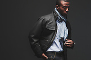 BIRMINGHAM, AL – DECEMBER 19, 2014: An African American male modeling fashionable men's outerwear.