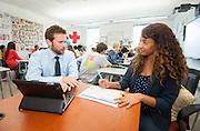 Teacher Development Specialist Chris Puente assists Erica Harris in her freshman English class at Carnegie Vanguard High School, May 10, 2013.