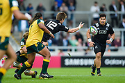 New Zealand centre Jordie Barrett off-loads to Alex Fidow during the World Rugby U20 Championship 5rd Place play-off  match Australia U20 -V- New Zealand U20 at The AJ Bell Stadium, Salford, Greater Manchester, England on Saturday, June  25  2016.(Steve Flynn/Image of Sport)